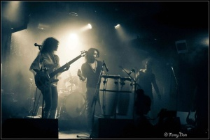 Triptone: Franck Jousselin on stage with bass guitarist and vocalist, Romy Valalik