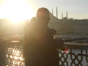 A local man fishing on the Bosphorus at sunset.