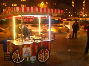 Street vendor selling roasted chestnuts during the winter climate
