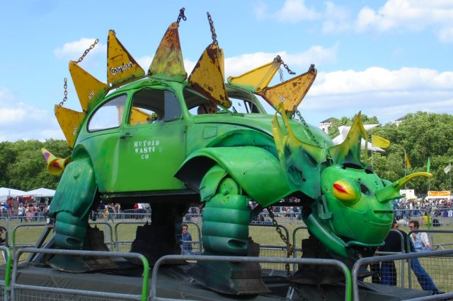 The infamous sculpture of the green VW Beetle 'towered over the Berlin Wall' with flashing lights symbolising a peace sign just weeks before the Wall fell.