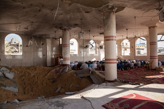 Muslims pray at a mosque in Gaza. @Luke Cody (2014)