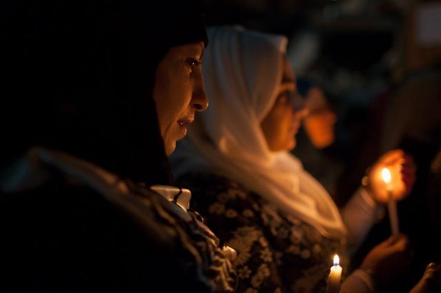 Women in Gaza pray for peace. @Luke Cody (Gaza 2014)